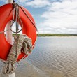 Life buoy and rope on boat — Stock Photo #35506913