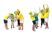 Brazilian fans stacking hands — Stock Photo