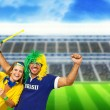 Brazilian couple supporters at stadium — Stock Photo