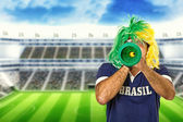 Brazilian fan celebrating a goal — Stock Photo