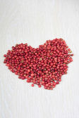 Dried rose pepper in shape of heart — Stock Photo