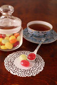 Tea with coloured sugar candies — Stock Photo