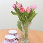 Tulips tea and present — Stock Photo