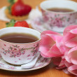 Tulips and tea — Stock Photo