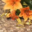 Orange lily with decorations — Stock Photo #19717299