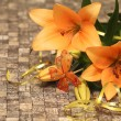 Orange lily with decorations — Stock Photo #19717329
