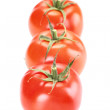 A group of three tomatoes on white background — Stock Photo