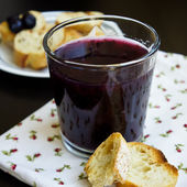 Blueberry jelly in a glass with ship biscuit on a black table view closeup — Stock Photo