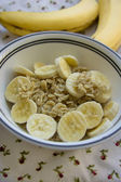 Banana oatmeal served on a table — Stok fotoğraf