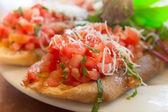 Wheat bruschetta with diced tomato salsa — Stock Photo