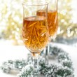 Stockfoto: Wine in glasses with christmas decorations and sparkling bokeh
