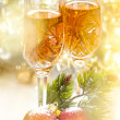 Стоковое фото: Wine in glasses with christmas decorations and sparkling bokeh