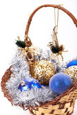 Basket full of blue silver and gold new year and christmas decorations — Stock Photo