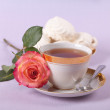 Stock Photo: Cup of tewith white souffle and rose flower