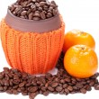 Stock Photo: Coffee beans in a ceramic cup with knitted cover on white