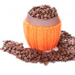 Coffee beans in a ceramic cup with knitted cover on white — Stock Photo
