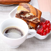 Pieces of marble cake on a table with a cup of coffee — Stock Photo