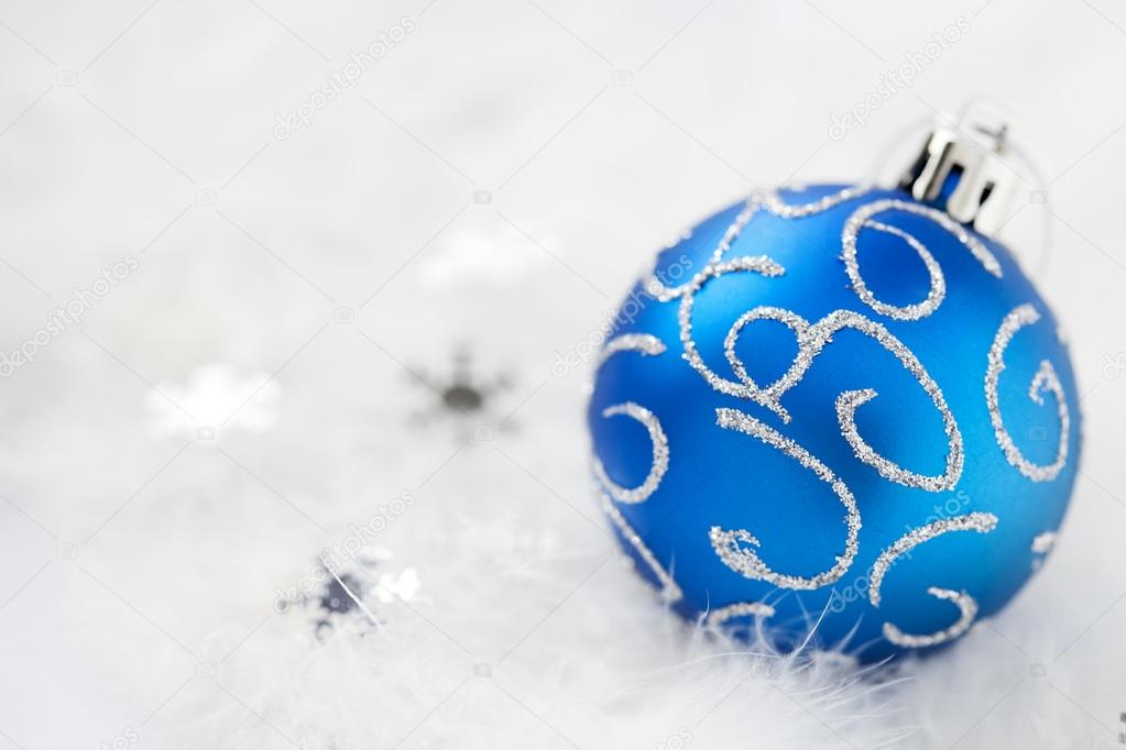 Blue christmas decoration ball on chrismas tree — Stock Photo #12803581