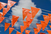 Dutch orange flags seen from beside — Stock Photo
