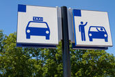Taxi and drop off sign — Stock Photo