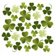 Stock Vector: Shamrocks background