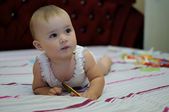 Baby on the bed — Stok fotoğraf