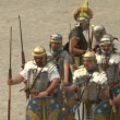 Stock Video: Romand gallic soldier during reenactment of war between Romans and Cottians