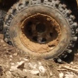 Close up of wheel on an off road vehicle in motion — Stock Video
