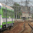 Italian commuter train crossing the city — ストックビデオ