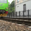 Italian commuter train crossing the city — Stock Video #13765397