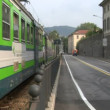 Italian commuter train crossing the city — Stock Video