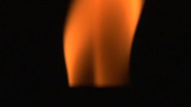Close-up of burning candle isolated on black background — Stock Video