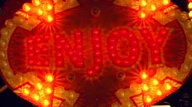 """enjoy"" sign lit up by light bulbs — Stock Video"