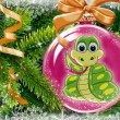 Green the snake in a New Year's toy on a fur tree - Stock Photo