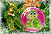 Green the snake in a New Year's toy on a fur tree — Stock Photo