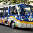 Tour bus in Waikiki, Hawaii - Stock Photo