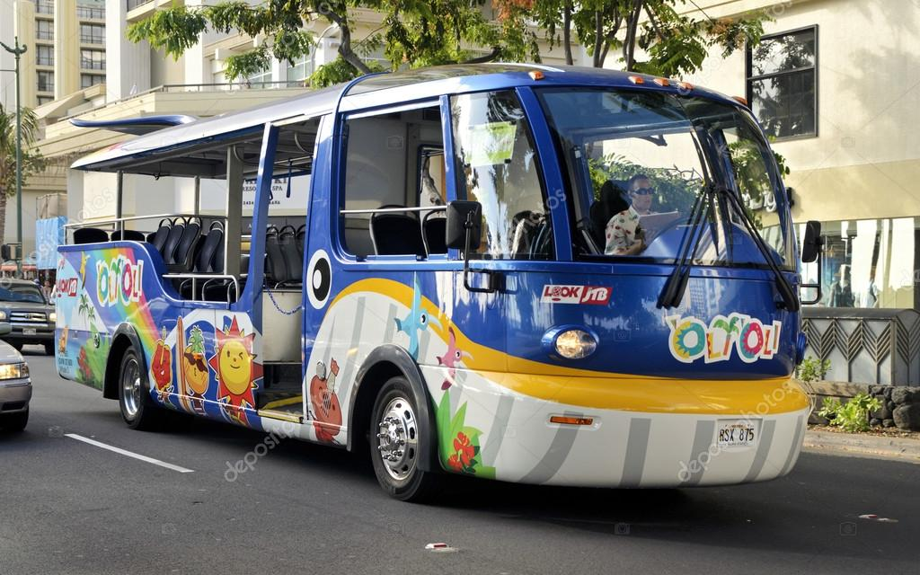 WAIKIKI, HAWAII - JULY 2012: An interesting decal design shown on a new bus.  Tour bus services provide travel services for hotel arrangements, sightseeing and activities around the island. — Stock Photo #12625668
