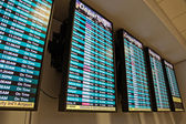 Airport departure board — Stock Photo