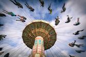 Spinning vintage swing ride — Stock Photo