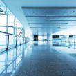 Stock Photo: Corridor in office building with big windows passing daylight