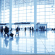 Passengers in the airport interior — Stock Photo