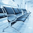 Empty airport terminal waiting arewith chairs. — Stock Photo #13260284