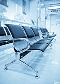 Empty airport terminal waiting area with chairs. — Stock Photo