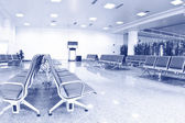 Empty airport terminal waiting area with chairs. — Stockfoto