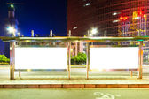 Blank billboard on bus stop at night — Stock Photo