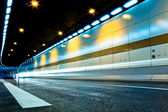 The tunnel at night, the lights formed a line — Stockfoto
