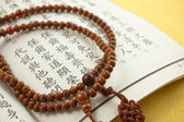 Buddhist or Hindu prayer beads,scripture — Stock Photo