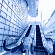 Blue moving escalator in the office hall perspective view — Stock Photo #13673115