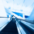 Blue moving escalator in the office hall perspective view — Stock Photo #13675747