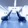 Blue moving escalator in the office hall perspective view — Stock Photo #13676662